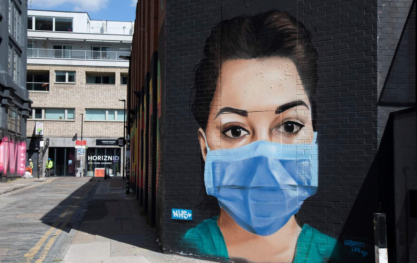A street mural of an NHS nurse wearing a face mask in Shoreditch, London. (Mike Kemp / In Pictures via Getty Images)